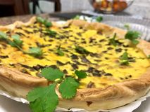 Mushroom quiche and egg from Portugal. This is a photograph of an eating done in Portugal by Portuguese, the mushroom quiche Royalty Free Stock Image