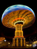 Mushroom Ride. Long exposure of a swing ride Stock Photos