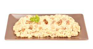 Mushroom Risotto. Cooked mushroom risotto in a horizontal brown plate, Italian typical food. Isolated on white Royalty Free Stock Image