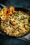 Mushroom Risotto in iron pan with herbs and parmesan cheese Royalty Free Stock Photos