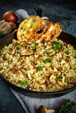 Mushroom Risotto in iron pan with herbs and parmesan cheese Stock Photography