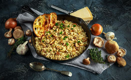 Mushroom Risotto in iron pan with herbs and parmesan cheese Royalty Free Stock Photo