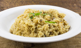 Mushroom risotto rice close up on rustic wood Stock Images