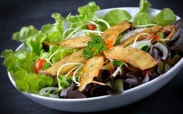 Mushroom salad on the white plate Stock Image