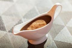 Mushroom sauce in gravy boat Stock Photography