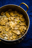 Mushroom sauce preparation Royalty Free Stock Photo