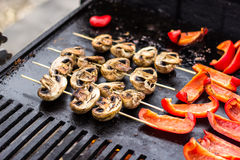 Mushroom skewers on grill Stock Image