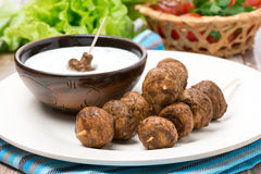 Mushroom skewers with yogurt sauce Royalty Free Stock Images