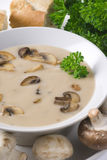 Mushroom Soup. With parsley and baguette in the background Stock Images