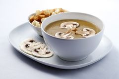 Mushroom soup. With dry bread in a plate on white background. Raw available stock photos