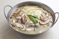 Mushroom soup. The mushroom Flammulina stewed soup royalty free stock images