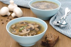 Mushroom soup in a blue bowl Royalty Free Stock Image