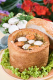 Mushroom soup in bread bowl. Outdoor on  flower background Royalty Free Stock Photography