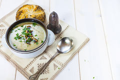 Mushroom soup with a bread roll and parsley Royalty Free Stock Image