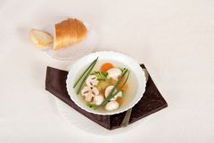 Mushroom soup, bread, spoon and bright napkin Royalty Free Stock Photos