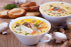 Mushroom soup with croutons. On a wooden board Stock Image