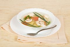 Mushroom soup, dish, spoon and napkin Royalty Free Stock Photo