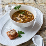 Mushroom soup with egg noodles Stock Photos