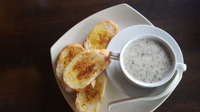 Mushroom Soup and Garlic Bread. Is one of the most popular breakfast menu, the picture is taken at a restaurant near the house Stock Photography