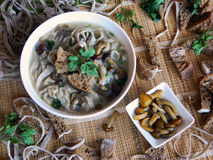 Mushroom soup. Soup with honey agarics, homemade noodles and rye crouton Royalty Free Stock Photo