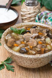 Mushroom soup with pearl barley, vertical Stock Image