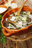 Mushroom soup in the plate on the table Stock Image