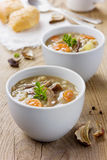 Mushroom soup on a rustic wooden table Royalty Free Stock Images