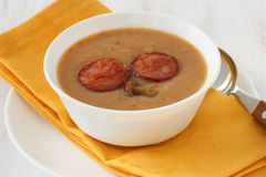 Mushroom soup with sausages Stock Photo
