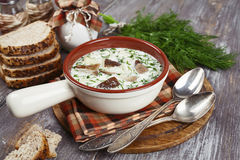 Mushroom soup. With sour cream  in the bowl on the table Royalty Free Stock Photography