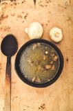Mushroom soup. With spoon and fresh vegetables on a rustic background Royalty Free Stock Image