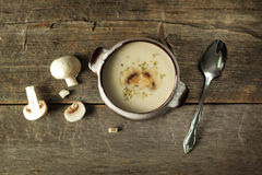 Mushroom soup. With spoon and fresh vegetables on a rustic background Stock Photos