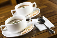 Mushroom Soup. Two cups of mushroom soup ready to be served Royalty Free Stock Photos