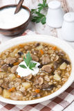 mushroom soup with vegetables and pearl barley, vertical Stock Photos