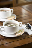 Mushroom Soup. Vertical shot of two cups of mushroom soup ready to be served Royalty Free Stock Photo