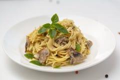 Mushroom Spaghetti Pasta and cream sauce. Homemade italian pasta with champignon mushroom. Close up. Selective focus stock photography