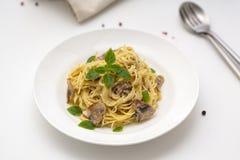 Mushroom Spaghetti Pasta and cream sauce. Homemade italian pasta with champignon mushroom. Selective focus stock photography