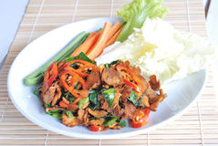 Mushroom spicy fried. Vegetarian food - mushroom spicy fried serves with fresh vegetable over bamboo mat royalty free stock images