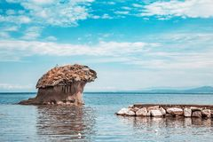 Mushroom stone of Lacco Ameno on Ischia Island in Italy. Travel in Italy, Ischia Island, Naples. Famous landmark and tourist destination royalty free stock photography