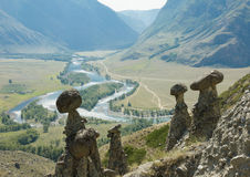 Mushroom stone and mountain stream in valley Royalty Free Stock Photo