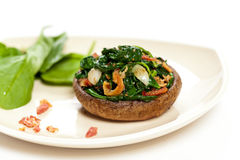 Mushroom stuffed with spinach Stock Photos