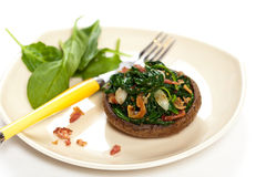 Mushroom stuffed with spinach Stock Image