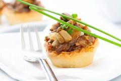 Mushroom tartlet appetizer Royalty Free Stock Images