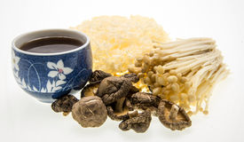 Mushroom tea and assortment of mushrooms. Stock Photos