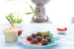 Mushroom vegan meatballs with hummus and fried tomato, Albóndigas veganas de champiñones con hummus y tomate frito stock image