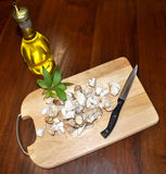 Mushrooms. Cut with sliced mushrooms and bottle of oil Stock Images