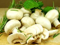 Mushrooms. Sliced mushrooms on wood whit herbs Royalty Free Stock Images