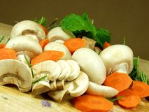 Mushrooms. Sliced mushrooms whit vegetables and herbs Stock Photo