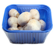 Mushrooms. Fresh White Button Mushrooms In A Retail Package Royalty Free Stock Photography