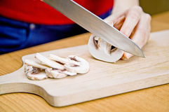 Mushrooms. Getting sliced in the kitchen Royalty Free Stock Photography