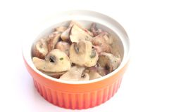 Mushrooms with bacon and cream Stock Images